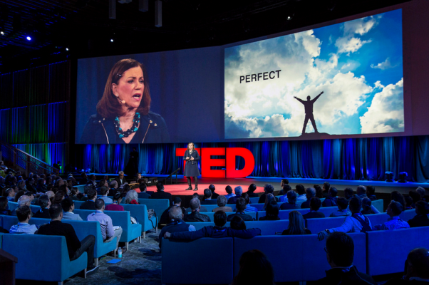 TED stage with female speaker
